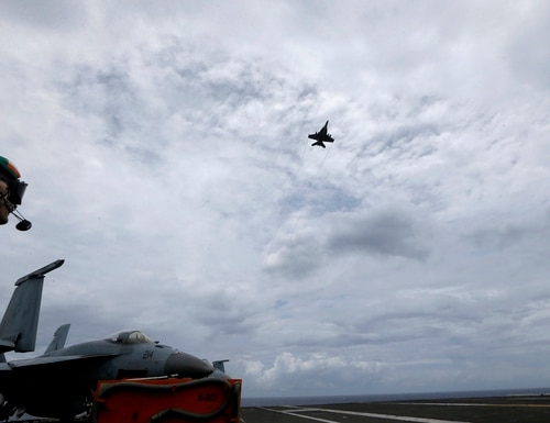 The aircraft carrier Ronald Reagan has sailed through the disputed South China Sea in the latest show of America's military might amid new territorial flareups involving China and three rival claimant states as Philippines, Vietnam and Malaysia. (Bullit Marquez/AP)