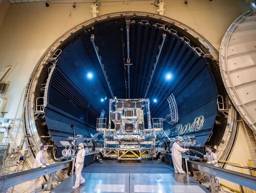 Lockheed Martin's SBIRS GEO-5 satellite, the first military space satellite built on the modernized LM 2100 bus, moves into the Thermal Vacuum (TVAC) test chamber. Testing successfully wrapped up June 9. (Lockheed Martin)