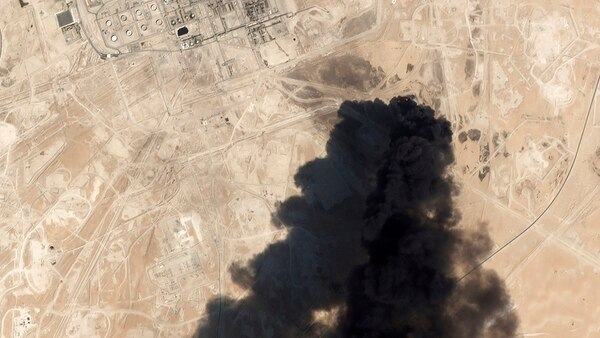 This satellite image Sept. 14, 2019, shows thick black smoke rising from Saudi Aramco's Abqaiq oil processing facility in Buqyaq, Saudi Arabia, after it was attacked by drones and cruise missiles. (Planet Labs via AP)
