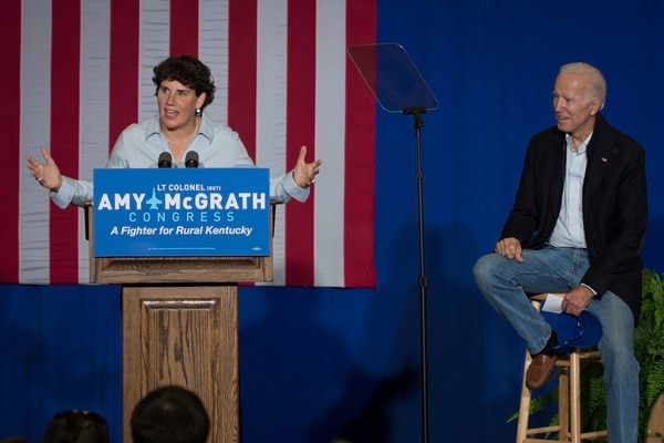 Former Vice President Joe Biden looks on as Democratic House candidate Amy McGrath speaks during a campaign event in Kentucky on Oct. 12, 2018. McGrath is a Marine Corps veteran. (Bryan Woolston/AP)