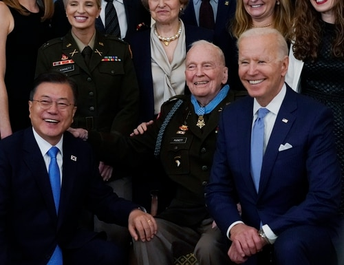 Bottom row, from left: South Korean President Moon Jae-in, retired U.S. Army Col. Ralph Puckett and President Joe Biden pose for a photo after Puckett was presented the Medal of Honor in the East Room of the White House, Friday, May 21. (AP Photo/Alex Brandon)