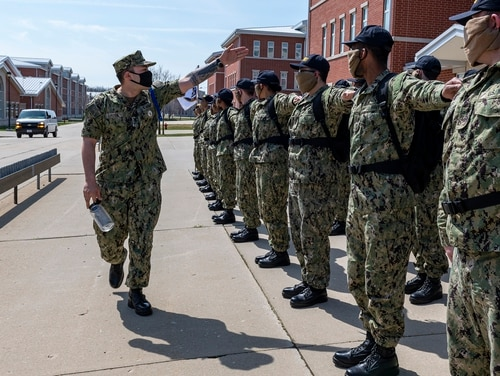 Recruits dress off in formation on the USS Chicago recruit barracks grinder April 11 at Recruit Training Command in Great Lakes, Ill. (MC1 Camilo Fernan/Navy)