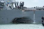 Stricken destroyer John S. McCain arrives in Singapore, 10 crew still missing