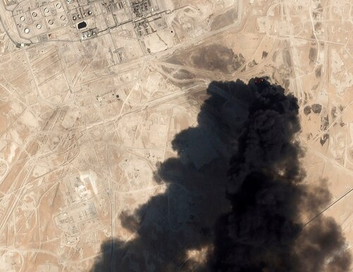This Saturday, Sept. 14, 2019, satellite image from Planet Labs Inc. shows thick black smoke rising from Saudi Aramco's Abqaiq oil processing facility in Buqyaq, Saudi Arabia. (Planet Labs Inc via AP)