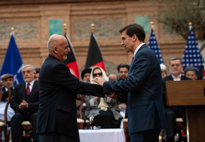 Defense Secretary Mark Esper, right, and Afghanistan President Ashraf Ghani shake hands at the U.S.-Afghanistan Joint Declaration Announcement at the Dilkusha Mansion Garden, Kabul, Afghanistan, Feb. 29, 2020. (Army Staff Sgt. Nicole Mejia/DoD)