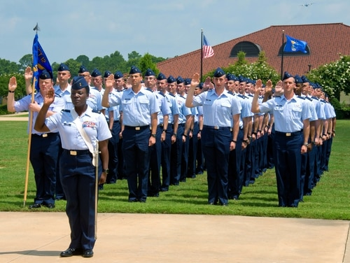 Officer Training School cadets take the oath of office during their graduation parade at Maxwell Air Force Base, Alabama, in June 2016. The Air Force will test a program that accelerates OTS training for senior noncommissioned officers from 40 days to 14. (Melanie Rodgers Cox/Air Force)