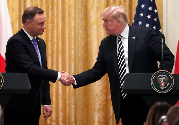 President Donald Trump shakes hands with Polish President Andrzej Duda, left, during a news conference in the East Room of the White House, Tuesday, Sept. 18, 2018, in Washington. (AP Photo/Alex Brandon)