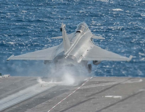 A French Navy Rafale Marine fighter aircraft launches from the U.S. Navy aircraft carrier George H.W. Bush during joint carrier flight operations. (Mark D. Faram/Staff)