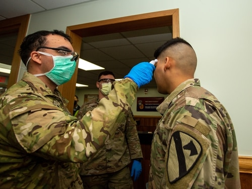 Soldiers stationed on Camp Casey submit to screening for coronavirus. (Sgt. Amber I. Smith/Army)