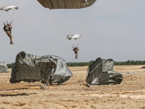 Paratroopers assigned to the British 16 Air Assault Brigade land on Holland Drop Zone on Fort Bragg, N.C., March 17, 2015. The jump certified the British paratroopers to conduct a joint forcible entry operation for the Combined Joint Operational Access Exercise led by 2nd BCT in April. The CJOAX represents a major milestone in the Division's interoperability program which seeks to create a seamless integration of a U.K. brigade into the Division and build operational compatibilities for multinational crisis response options. (82nd Airborne Division photo by Staff Sgt. Jason Hull/Released)