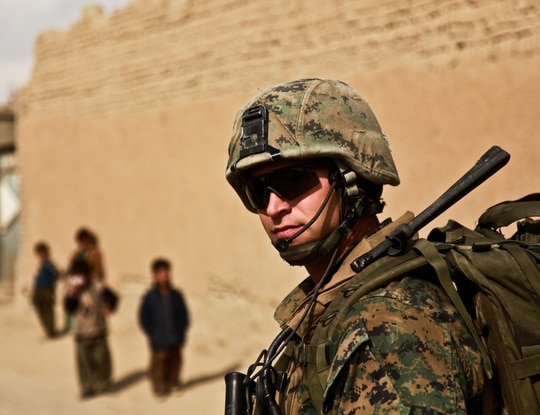 Navy HM2 Joshua Hervas, assigned to Marine Embedded Training Team 1-12, takes part in a patrol near the village of Dehayat, Afghanistan, on Nov. 7, 2009. (Capt. Rock Stevens/Army)