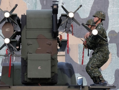 Taiwan soldiers load home-made Tien Chien surface-to-air missiles onto a launcher during an annual simulation of an attack by China as the government sought to reassure the public in the face of deteriorating relations with Beijing. (Sam Yeh/AFP/Getty Images)