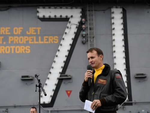 Capt. Brett Crozier, former commanding officer of the aircraft carrier USS Theodore Roosevelt (CVN 71), addressed the crew during an all-hands call on the ship's flight deck. in November. (U.S. Navy photo by Mass Communication Specialist 3rd Class Nicholas Huynh)