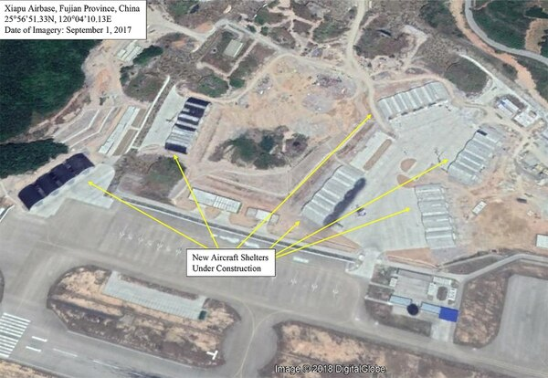 A satellite photo of Xiapu air base dated September 2017 showing the aircraft shelters being built. More recent satellite photos show these are close to completion. (Google, with annotation by Mike Yeo/Staff)