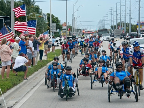 Flag wavers greet wounded soldiers traversing the Florida Keys Overseas Highway in January 2016. The event was part of the annual Wounded Warrior Project Soldier Ride. (Andy Newman/AP)