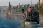 American troops start pullout from along Turkey's border in Syria