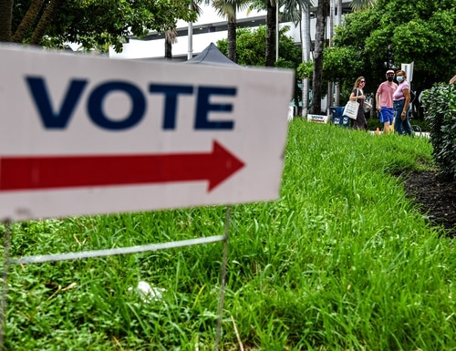 Voters wait in line to cast their early ballots at Miami Beach City Hall in Miami Beach, Fla., on Oct. 20, 2020. (Chandan Khanna/AFP via Getty Images)