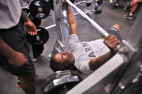 Pfc. Karmen Bosket, an administration specialist with Headquarters and Headquarters Company, 330th Transportation Company, and a Fort Lauderdale, Fla., native, prepares to compete in the bench press competition during Provider Week at Dahl Gym Sept. 10. Bosket tied for first place in her weight class.
