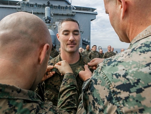 Marine Corps Maj. Joseph P. Murphy, commander of troops aboard the USS Oak Hill, receives his formal promotion during a ceremony on the Mediterranean Sea on March 1, 2018. New rules governing officer personnel rules will go into place later this month when the annual defense authorization act is signed into law. (Staff Sgt. Dengrier M. Baez/Marine Corps)