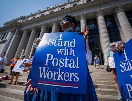 Retired postal worker Glenda Morris protests postal cutbacks, Tuesday, Aug. 25, 2020, in New York. (Robert Bumsted/AP)