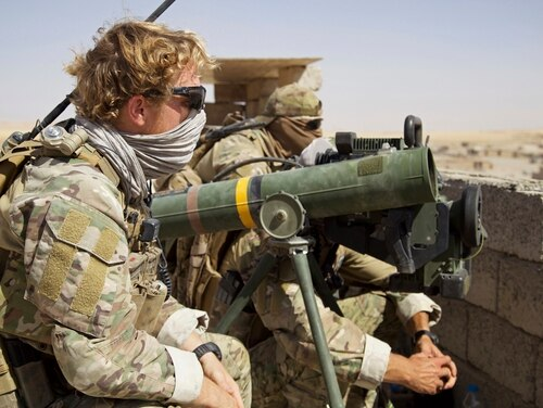 Belgian special forces soldiers sit on a rooftop with a guided-missile launcher, a few miles from the frontline, in the village of Abu Ghaddur, east of Tal Afar, Iraq, Sunday, Aug. 20, 2017. Iraqi forces have launched a multi-pronged assault to retake the town of Tal Afar, west of Mosul, marking the next phase in the country's war on the Islamic State group. Tal Afar and the surrounding area is one of the last pockets of IS-held territory in Iraq after victory was declared in July in Mosul, the country's second-largest city. (AP Photo/Balint Szlanko)