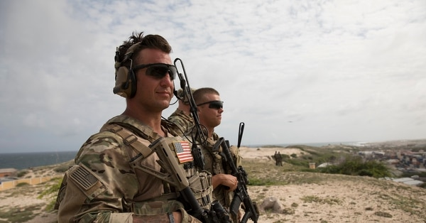 U.S. Army soldiers look out at Mogadishu, Somalia. (National Geographic/James Peterson)