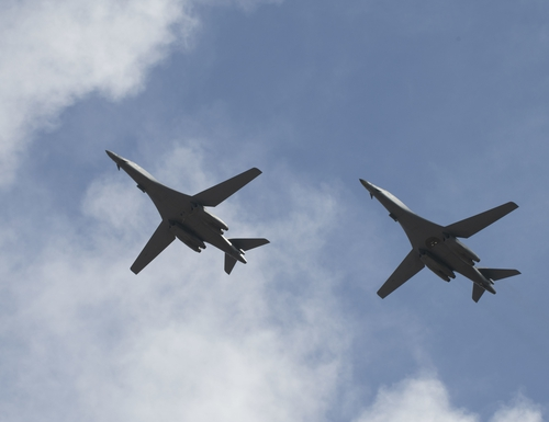 Two B-1B Lancers, assigned to the 28th Bomb Wing from Ellsworth Air Force Base, S.D., conduct a flyover before landing at Andersen Air Force Base, Guam. (Airman 1st Class Christina Bennett/Air Force)