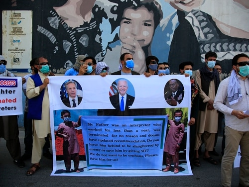 Former Afghan interpreters hold placards during a demonstrations in front of the U.S. Embassy in Kabul, Afghanistan, June 25, 2021. (AP Photo/Mariam Zuhaib)