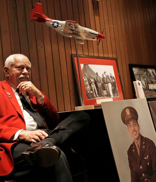In this Tuesday, Feb. 25, 2020 photo, Howard L. Baugh, son of Tuskegee Airman Lt. Col. Howard L. Baugh, listens to his brother Richard Baugh speak about the Tuskegee Airmen at the Virginia War Memorial in Richmond, Va. (Alexa Welch Edlund/Richmond Times-Dispatch via AP)