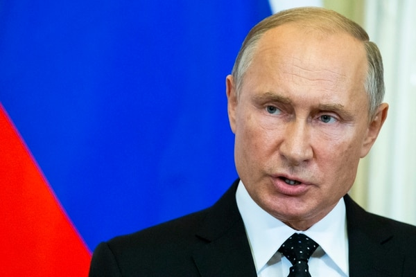 Russian President Vladimir Putin speaks to the media during a joint news conference with Hungarian Prime Minister Viktor Orban after their talks in the Kremlin in Moscow on Tuesday, Sept. 18, 2018. Putin says