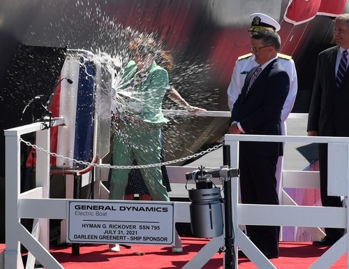 Sarah Greenert McNichol, Matron of Honor for the pre-commissioning unit (PCU) Hyman G. Rickover (SSN 795), christens the ship during a ceremony at General Dynamics Electric Boat shipyard facility in Groton, Connecticut, July 31, 2021. (Chief Petty Officer Joshua Karsten/Marine Corps)