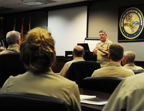 150828-N-PU674-002 PENSACOLA, Fla. (Aug. 28, 2015) Rear Adm. Daniel J. MacDonnell, commander of Information Dominance Corps Reserve Command (IDCRC) and reserve deputy commander of Navy Information Dominance Forces (NAVIDFOR), delivers remarks during a three-day symposium for senior Reserve information warfare officers. Held at the Center for Information Dominance, the meeting brought together leaders to discuss a variety of issues affecting career progression and retention for both Reserve officers and enlisted personnel within the Information Dominance Corps. (U.S. Navy photo by Carla M. McCarthy/Released)