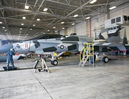 Sailors work on aircraft at VFC-12's hangar at NAS Occeana in Virginia Beach, Va., on Wednesday, October 28, 2015.