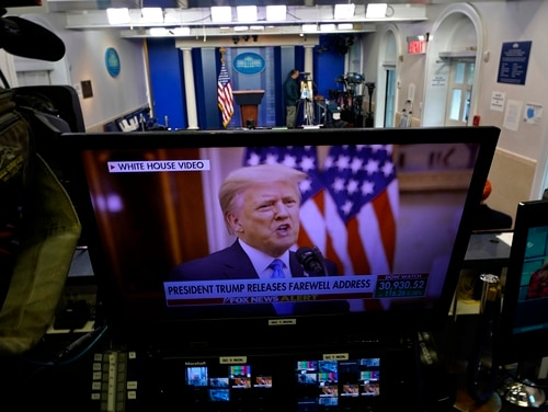 President Trump is seen on a network monitor after his pre-recorded farewell speech was released, inside the Brady Press Briefing Room at the White House, Tuesday, Jan. 19, 2021, in Washington. (Gerald Herbert/AP)