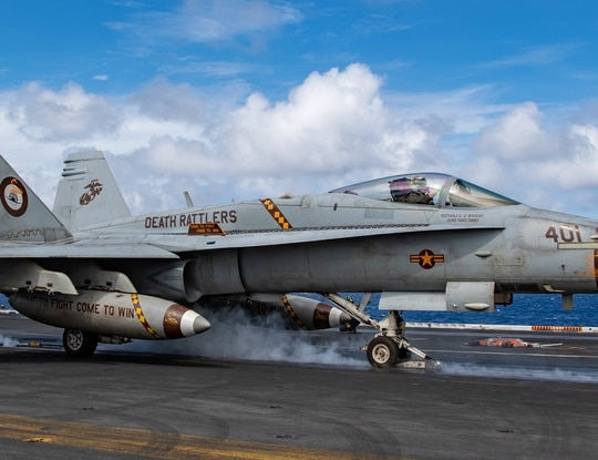 "An F/A-18C Hornet, from the ""Death Rattlers"" of Marine Fighter Attack Squadron (VMFA) 323, launches off the flight deck of the USS Nimitz (CVN 68). (Mass Communication Specialist 3rd Class Charles DeParlier/Navy)"