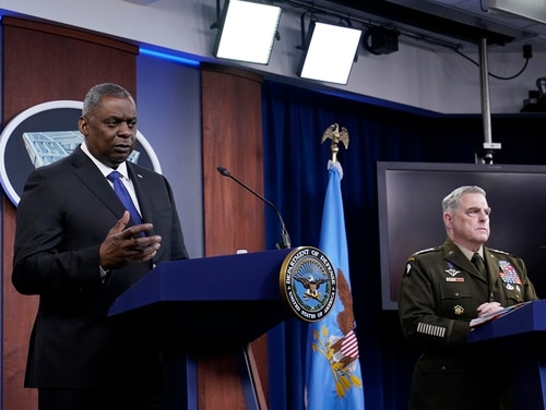 Defense Secretary Lloyd Austin, left, and Gen. Mark Milley, chairman of the Joint Chiefs of Staff, participate in a briefing at the Pentagon in Washington on May 6, 2021. (Susan Walsh/AP)