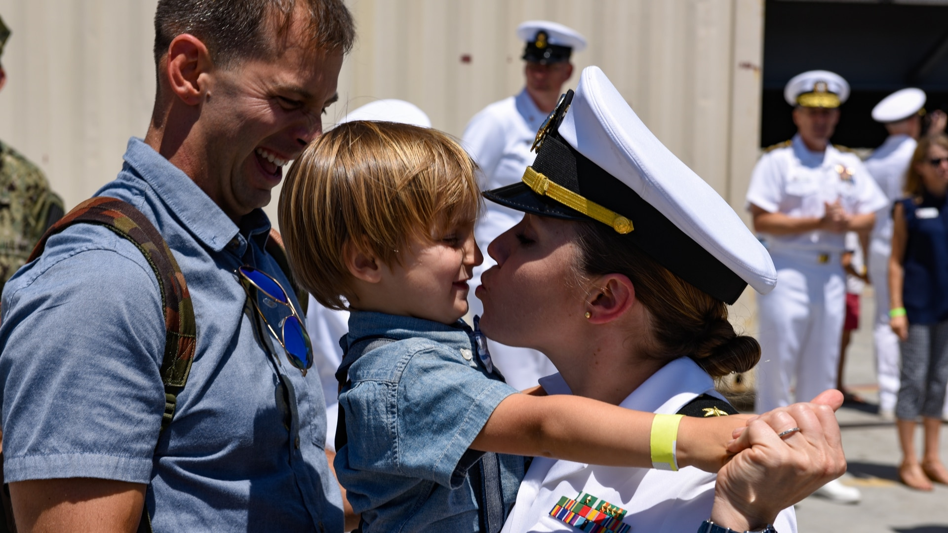 Lt. Cmdr. Beth Teach greets her family on the pier after the return of the aircraft carrier Theodore Roosevelt. (MC3 Andrew Langholf/Navy)