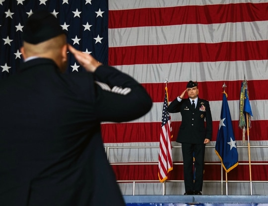 Col. Lawrence T. Sullivan, incoming 20th Fighter Wing commander, receives his first salute as commander from Chief Master Sgt. Steve C. Cenov, incoming 20th FW command chief. (Airman 1st Class Destani K. Matheny/Air Force)
