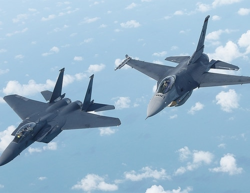 The F-16C, right, and F-15SG, left, aircraft are the Republic of Singapore Air Force's front-line fighters. (Mike Yeo/Staff)