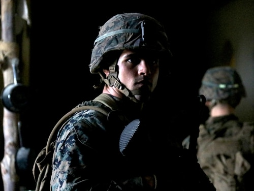 A Marine with 3rd Battalion, 8th Marine Regiment, passes information to his squad before a simulated combat patrol in the Infantry Immersion Trainer, Camp Lejeune, North Carolina, July 16. (1st Lt. Christin St. John/Marine Corps)
