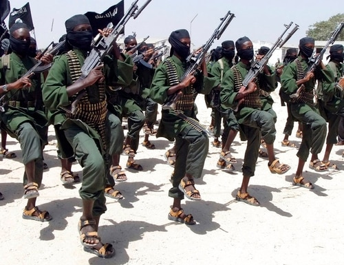 In this Feb. 17, 2011 photo, hundreds of newly trained al-Shabab fighters perform military exercises in the Lafofe area some 18 km south of Mogadishu, in Somalia. (Farah Abdi Warsameh/AP)