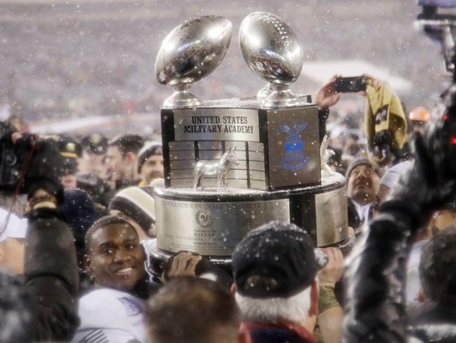 Army quarterback Ahmad Bradshaw holds up the Commander-in-Chief's Trophy after Army defeated Navy in December 2017. It's been a year since Air Force lost the Commander-in-Chief's Trophy, and the Falcons want it back. (Matt Rourke/AP)