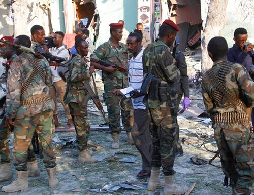 Heavily armed Somali soldiers seal the area after a car bomb exploded in Mogadishu, Somalia, on March 22, 2018. (Farah Abdi Warsameh/AP)