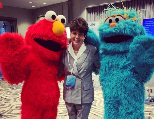 Patricia Barron, pictured here with Elmo and Rosita, was on the advisory committee for Sesame Workshop's programs to support military families. (Courtesy of Patricia Barron)