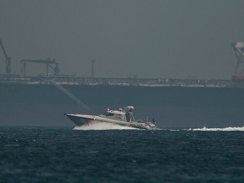 An Emirati coast guard vessel passes an oil tanker off the coast of Fujairah, United Arab Emirates, Monday, May 13, 2019. (Jon Gambrell/AP)