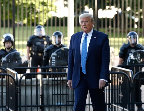 President Donald Trump walks in Lafayette Park to visit outside St. John's Church across from the White House Monday, June 1, 2020, in Washington. Part of the church was set on fire during protests on Sunday night. (Patrick Semansky/AP)