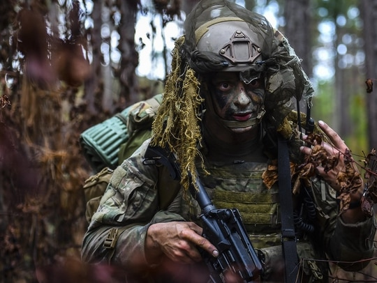 A Combat Control School student scans the woods as rear security for his unit during a field training exercise at Camp Mackall, N.C., in August 2016. Combat Controller School is home to a 13-week course that provides initial CCT qualifications. (Senior Airman Ryan Conroy/Air Force)