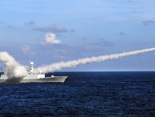 In this July 8, 2016, file photo released by Xinhua News Agency, Chinese missile frigate Yuncheng launches an anti-ship missile during a military exercise in the waters near south China's Hainan Island and Paracel Islands. (Zha Chunming/Xinhua via AP)
