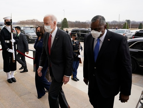 President Joe Biden and Vice President Kamala Harris walk with Secretary of Defense Lloyd Austin at the Pentagon, Wednesday, Feb. 10, 2021, in Washington. (Alex Brandon/Pool via AP)