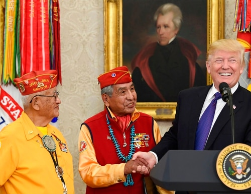 President Donald Trump, right, meets with Navajo Code Talkers Peter MacDonald, center, and Thomas Begay, left, in the Oval Office of the White House in Washington, Monday, Nov. 27, 2017. (Susan Walsh/AP)